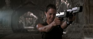 In her Summit keynote speech, Angelina Jolie aimed her weapons straight at the rapists. (screenshot of Lara Croft: Tomb Raider)