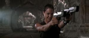 In her Summit keynote speech, Angelina Jolie aimed her weapons straight at the rapists. (screenshot of Lara Croft: Tomb Raider)